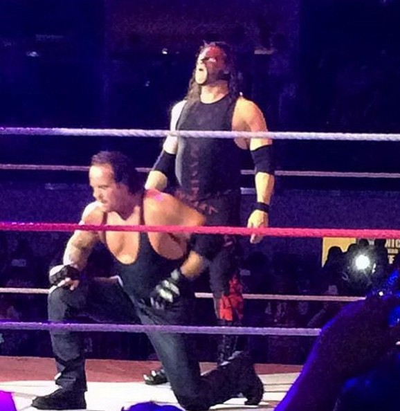 Undertaker and Kane do their signature pose