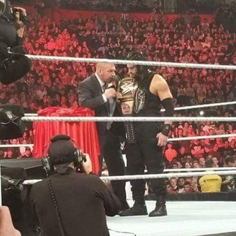 Roman Reigns & Triple H with vacant WWE World Title