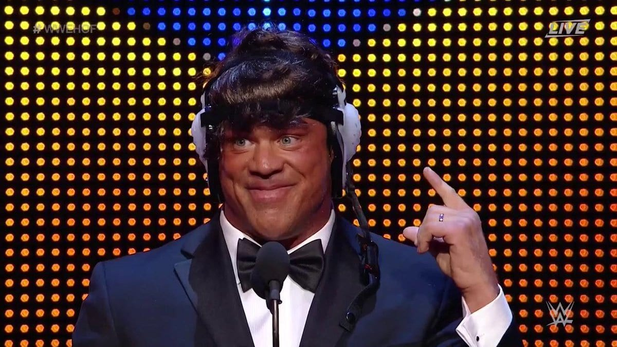 Kurt Angle puts on his wig with head gear at the WWE Hall of Fame Class of 2017