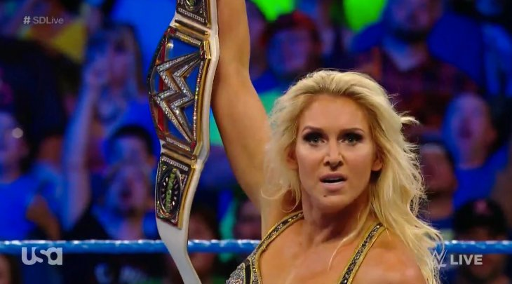 Charlotte Flair with the SmackDown Women's Championship
