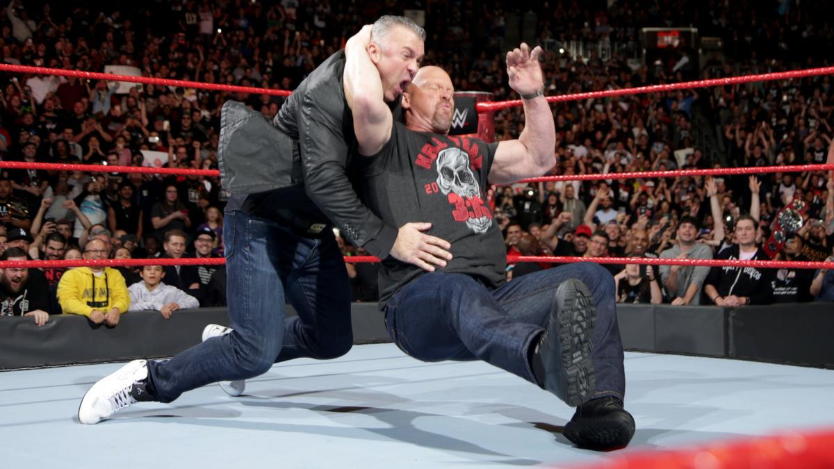 Stone Cold Steve Austin hits a Stone Cold Stunner on Shane McMahon at Raw 25