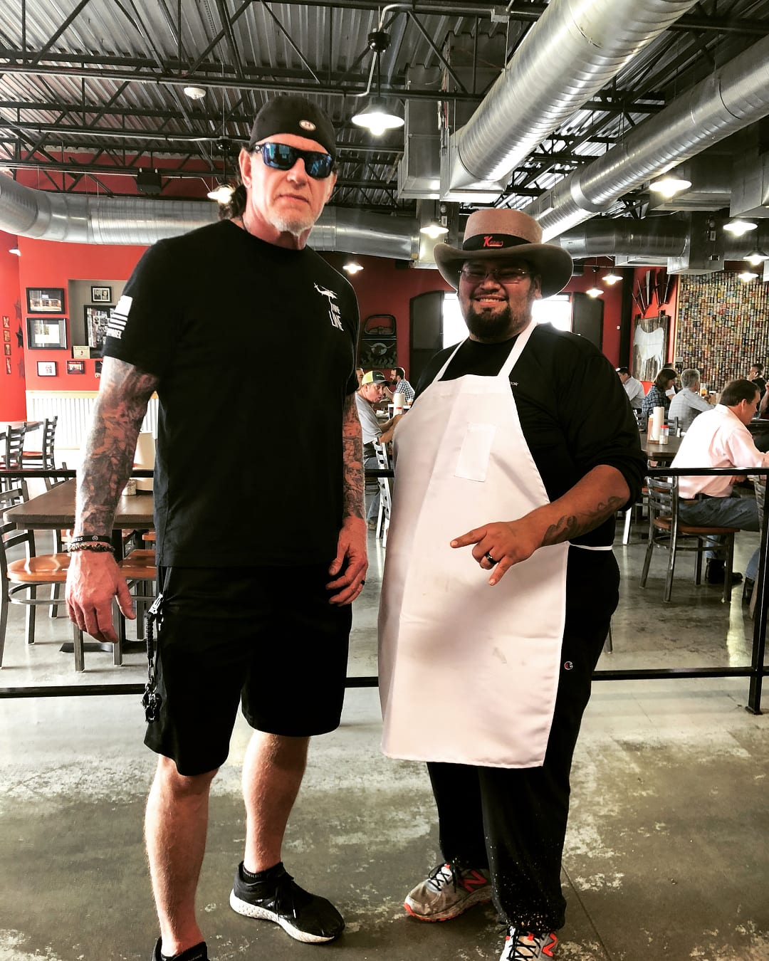 The Undertaker with a fan in 2018 - 1