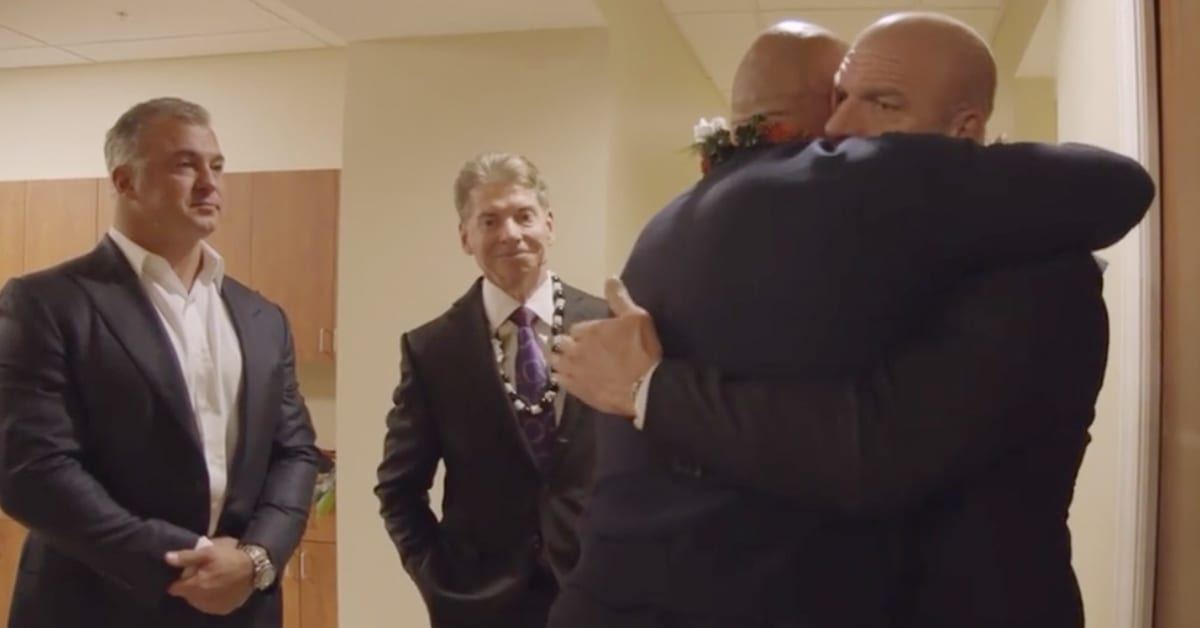 Shane McMahon Vince McMahon Triple H The Rock Hug At Rocky Johnson's Funeral