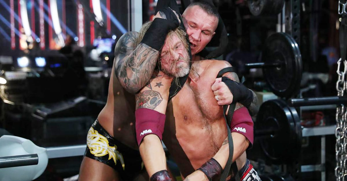 Randy Orton wraps weight-lifting equipment around Edge's neck during Last Man Standing match at WrestleMania 36