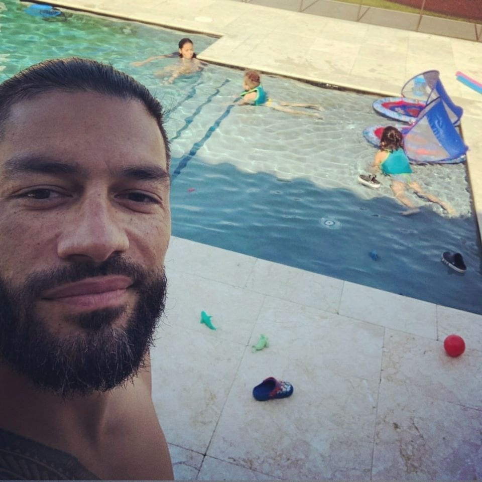 Roman Reigns spending time with his kids at the pool