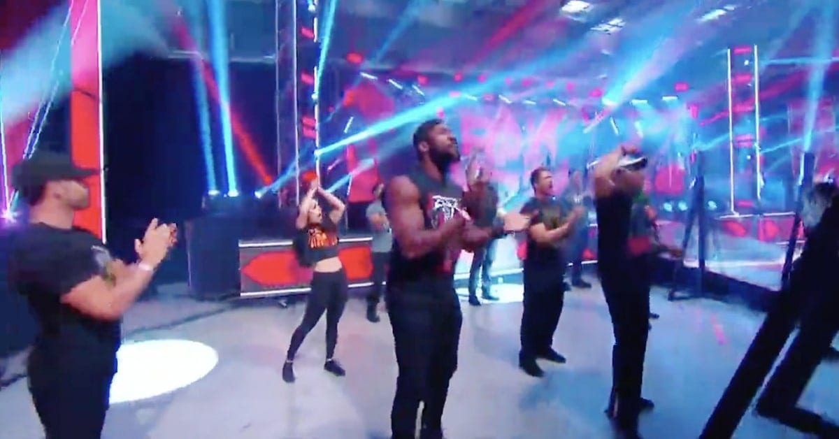 WWE Performance Center Trainees Standing As Fans In The Crowd On RAW 2020