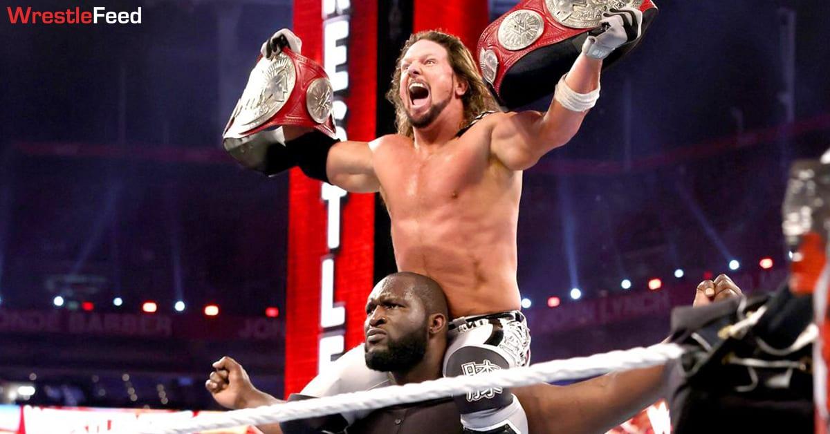 AJ Styles Omos posing with RAW Tag Team Championship at WrestleMania 37 WrestleFeed App