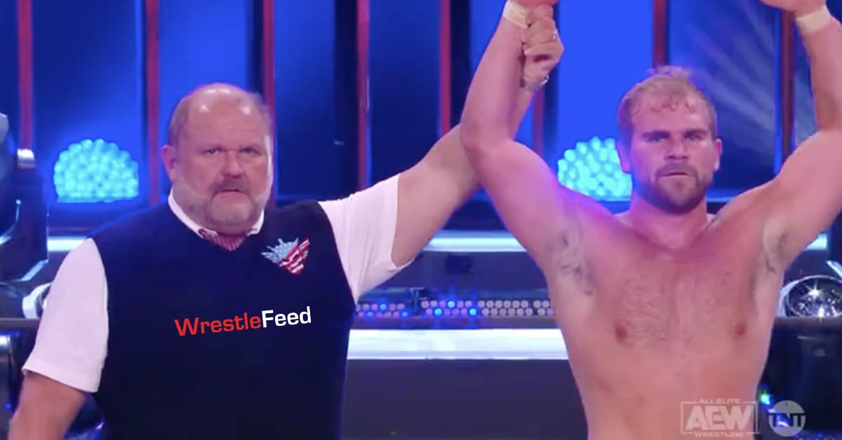 Arn Anderson raises his son Brock Anderson's hand after AEW Dynamite debut win WrestleFeed App
