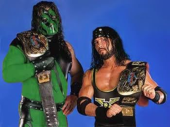 Kane in a green ring outfit and mask with X-Pac WWF Tag Team Champions