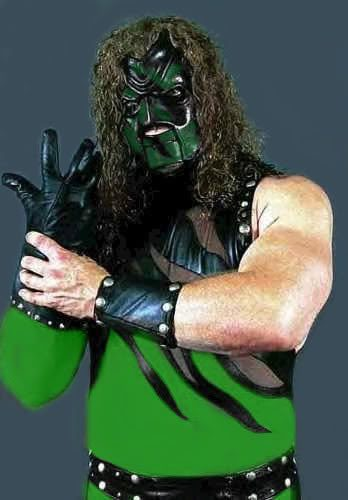 Kane in a green ring outfit and mask