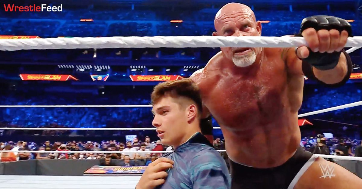 Goldberg chokes his son Gage with his shirt in the ring at WWE SummerSlam 2021 WrestleFeed App