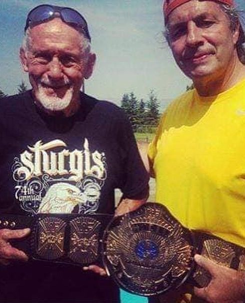 Reggie Parks posing with Bret Hart and his designed WWF Championship winged eagle belt